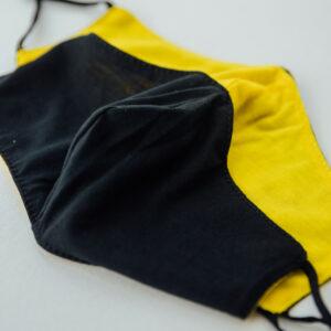 Divpusēja sejas maska - melna ar dzeltenu
