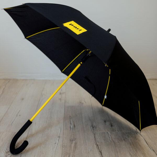 """Melns lietussargs ar dzelteniem spieķiem un Kustības """"Par!"""" logo"""